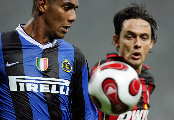 AC Milan defender Douglas Maicon (L) vie Pictures | Getty Images
