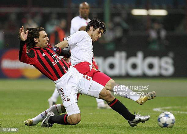 AC Milan midfielder Andrea Pirlo vies with Olympique Lyon's Brazilian midfielder Juninho during their Champions League quarterfinal 2nd leg football...