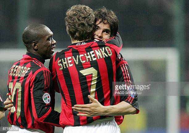 AC Milan midfielder Kaka is congratulated by teammates Clarence Seedorf and Andriy Shevchenko after scoring a goal against Fiorentina during their...