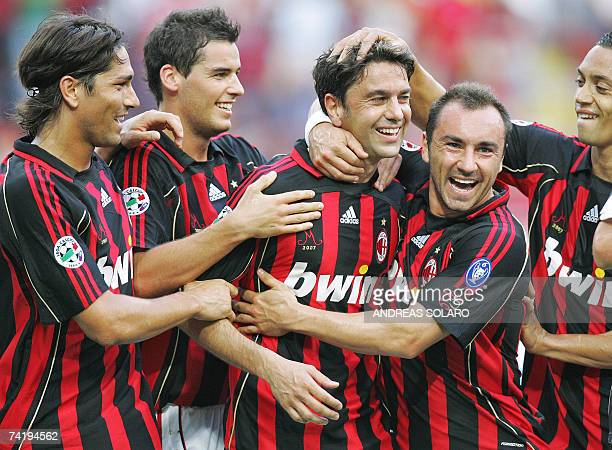 AC Milan's captain defender Alessandro Costacurta celebrates with teammates after scoring a goal against Udinese during his last macth of Italian...