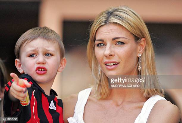 AC Milan's captain defender Alessandro Costacurta's wife Martina Colombari and her son Achille look on during the Italian serie A football match at...