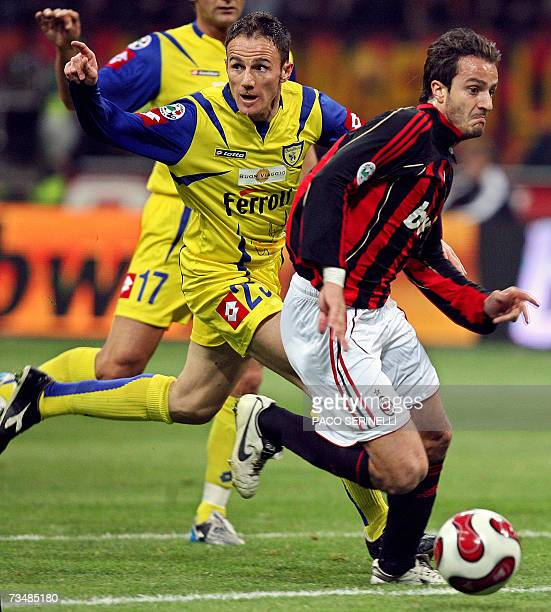 Milan's forward Alberto Gilardino vies with Chievo's defender Salvatore Lanna during their italian serie A football match at San Siro stadium in...