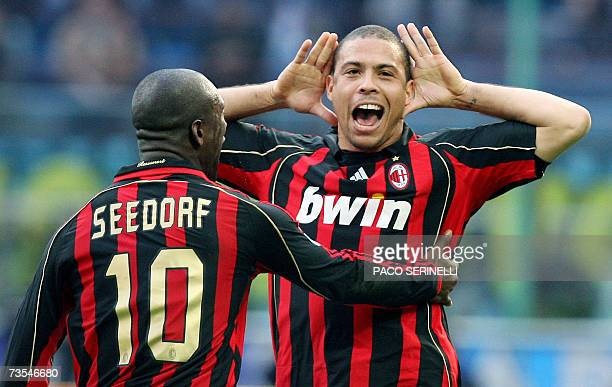 AC Milan's forward Ronaldo of Brazil is congratulated by his teammate Clarence Seedorf of the Netherlands after scoring a goal against Inter Milan...