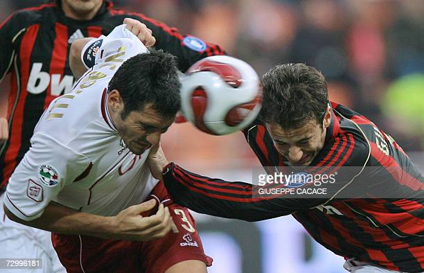 AC Milan's forwards Alberto Gilardino heads the ball with Reggina's defender Alessandro Lucarelli during their Serie A match at San Siro Stadium 14...