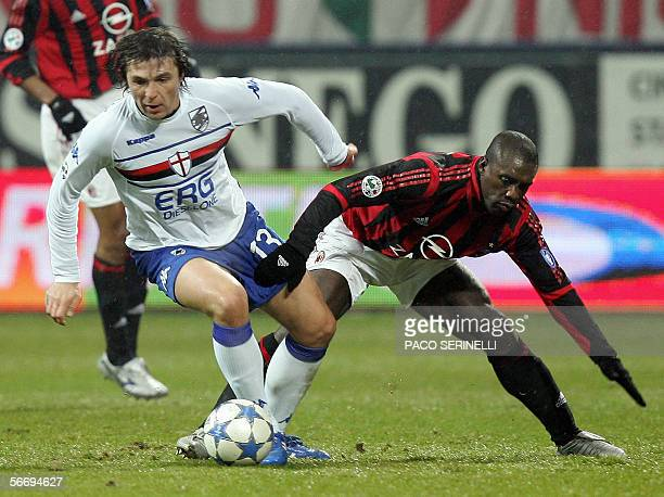 Milan's midfielder Clarence Seedorf fights for the ball with Sampdoria's forward Vitali Kutuzov during their serie A football match AC...