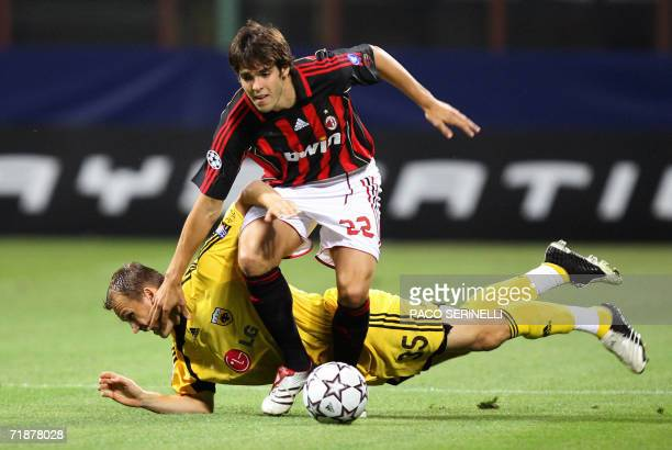 AC Milan's midfielder Kaka of Brazil fights for the ball with AEK Athens' midfielder Emerson of Brazil during their Champions League Group H football...