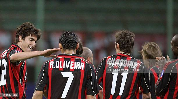 AC Milan's midfielder Ricardo Kaka of Brazil jubilates with teammates after scoring his third goal against Anderlecht's during their group H...