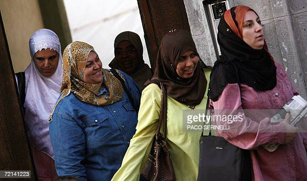 Arab women wait outside the Naguib Mahfouz School a private school mainly for Egyptian children whose curriculum includes Koran studies in Milan 11...