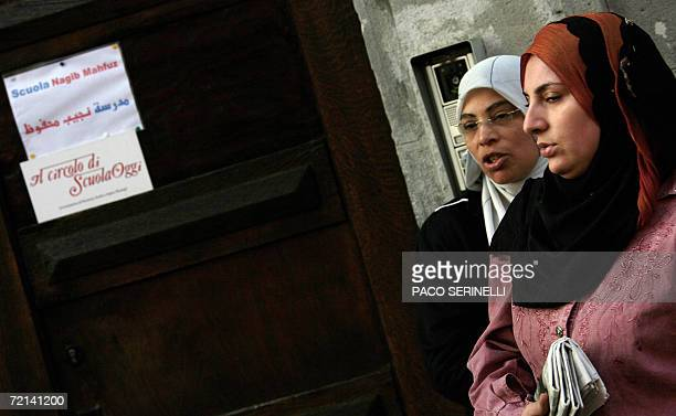 Arabic women wait outside the Naguib Mahfouz School a private school mainly for Egyptian children whose curriculum includes Koran studies in Milan 11...