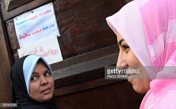 Arabic women walk into the Naguib Mahfouz School a private school mainly for Egyptian children whose curriculum includes Koran studies in Milan 11...