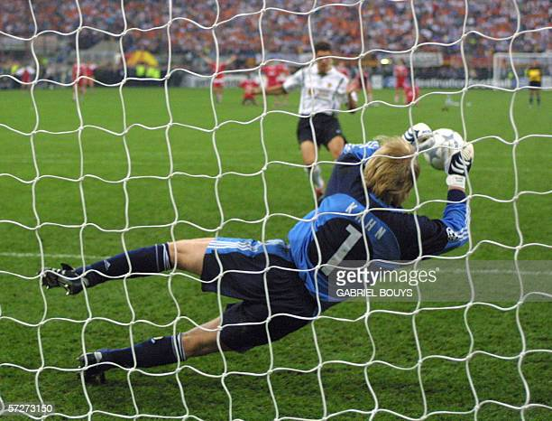 Bayern Munich's goalkeeper Oliver Kahn stops a penalty kick during the European football Champions League final match between Bayern Munich and...