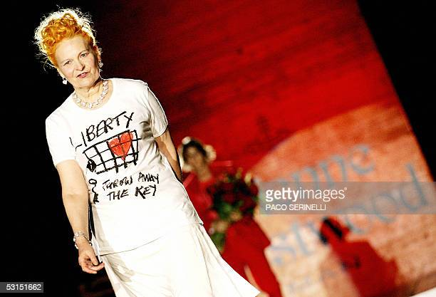 British designer Vivienne Westwood acknowledges the applause at the end of her show following the presentation of the men's SpringSummer 2006...