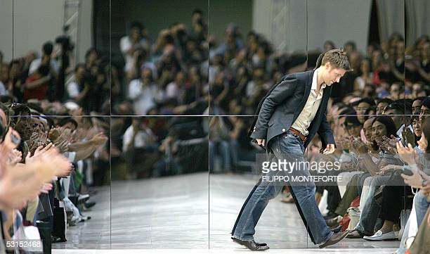 British fashion designer Christopher Bailey acknowledges the applause of the audience after presenting Burberry Prorsum Spring/Summer 2006 men's...