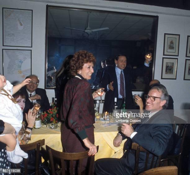 Milan Italy Fashion stylist Nicola Trussardi with Silvio Berlusconi Anna Craxi and Italian actress Adriana Asti toasting at Restaurant Garibaldi in...
