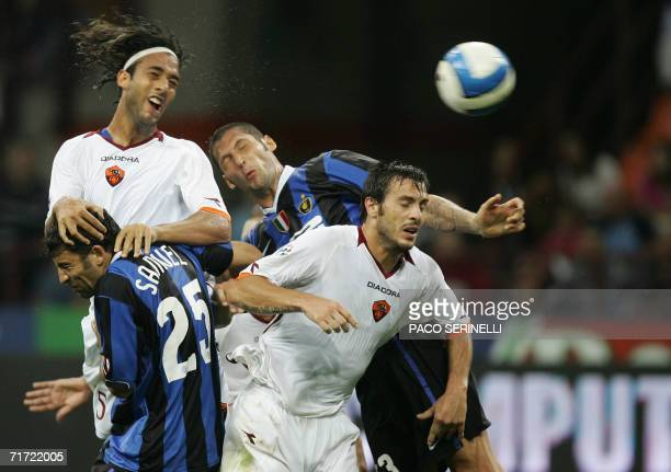 Inter Milan's defenders Walter Samuel and Marco Materazzi fight for the ball with AS Roma's Hossam Hussein Mido and Marco Cassetti during their...