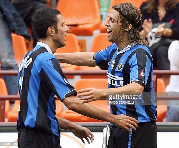 Inter Milan's forward Hernan Crespo is congratulated by his teammate Fabio Grosso after scoring a goal against Chievo Verona during their Serie A...
