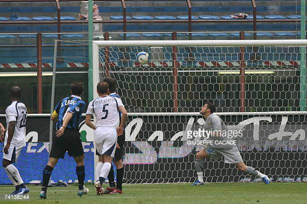 Inter Milan's goalkeeper Julio Caesar looks at the ball after the penalty kicked by Lazio's Cristian Ledesma during their Serie A match at San Siro...