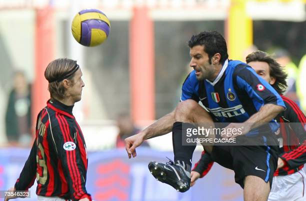 Inter's midfielder Luis Figo of Portugal challenges for the ball with AC Milan's midfielder Massimo Ambrosini during their Serie A fottball match at...