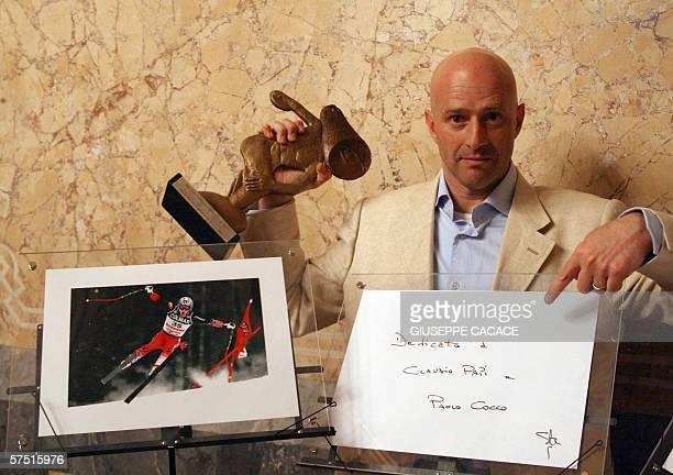 "Italian photographer Stefano Rellandini of Reuters receives the ""Omega Italian Sport photographer award "" from Vito Liverani owner of Omega agency..."
