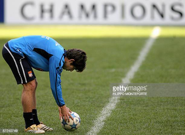 Lyon's Brazilian midfielder Juninho adjusts the ball to the ground during a training session a day before Champion's League quarter final second leg...