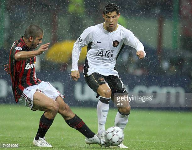 Manchester United's Portuguese forward Cristiano Ronaldo fights for the ball with an AC Milan player during their Champion's League second leg...