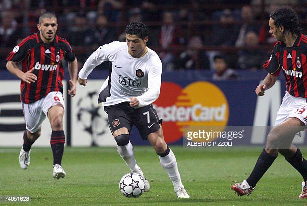 Manchester United's Portuguese forward Cristiano Ronaldo is chased for the ball controlled by AC Milan's defender Alessandro Nesta and midfielder...