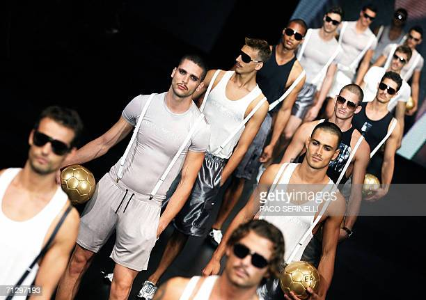 Models display creations by Emporio Armani's Spring-Summer 2007 men's collection as part of Milan's fashion shows, 26 June 2006. AFP PHOTO / Paco...