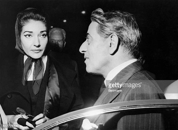Milan, Italy: Romance denied. Millionaire Greek shipowner Aristotle Onassis talks with opera star Maria Meneghini Callas outside the LaScala Opera...