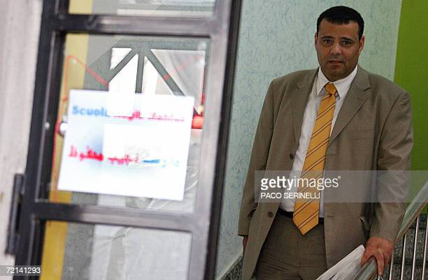 The Naguib Mahfouz School's founder 43 yearold Egyptian businessman Mahmoud Othman poses for a picture at the school in Milan 11 October 2006 Local...