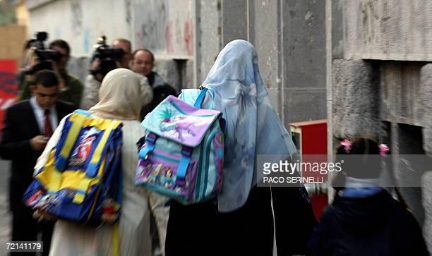 TV cameramen film parents accompanying their children into the Naguib Mahfouz School a private school mainly for Egyptian children whose curriculum...