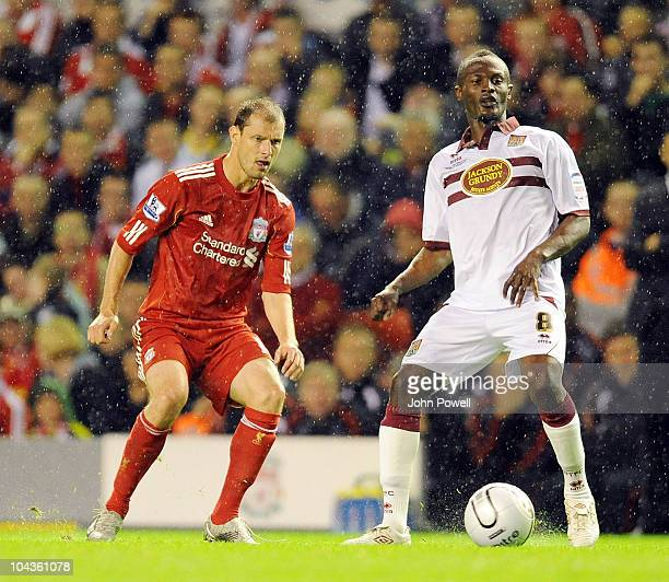 Milan jovanovic of Liverpool closes down Abdul Osman of Northampton Town during the Carling Cup 3rd round game between Liverpool and Northampton Town...