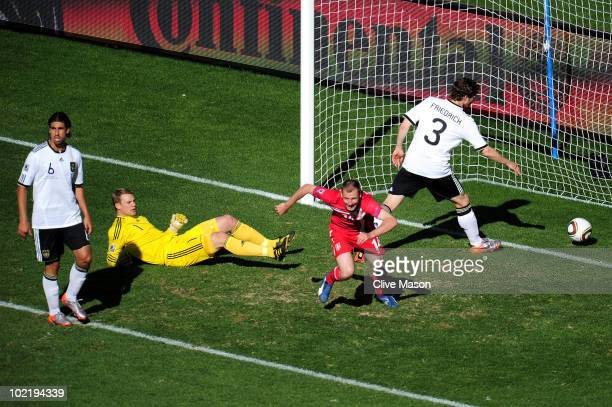 Milan Jovanovic of Serbia celebrates scoring the first goal past Manuel Neuer of Germany during the 2010 FIFA World Cup South Africa Group D match...