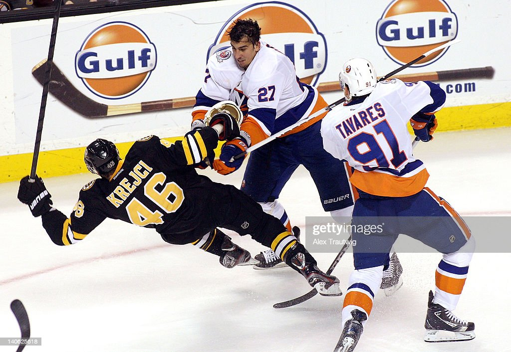 Milan Jurcina #27 of the New York Islanders checks David Krejci #46 of the Boston Bruins at TD Garden on March 3, 2012 in Boston, Massachusetts. The Islanders defeated the Bruins 3-2.