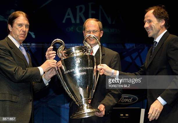 Milan legends Cesare Maldini and Franco Baresi hold the UEFA Champions League Cup with UEFA Chief Lars Christer Olsson during a ceremony in...