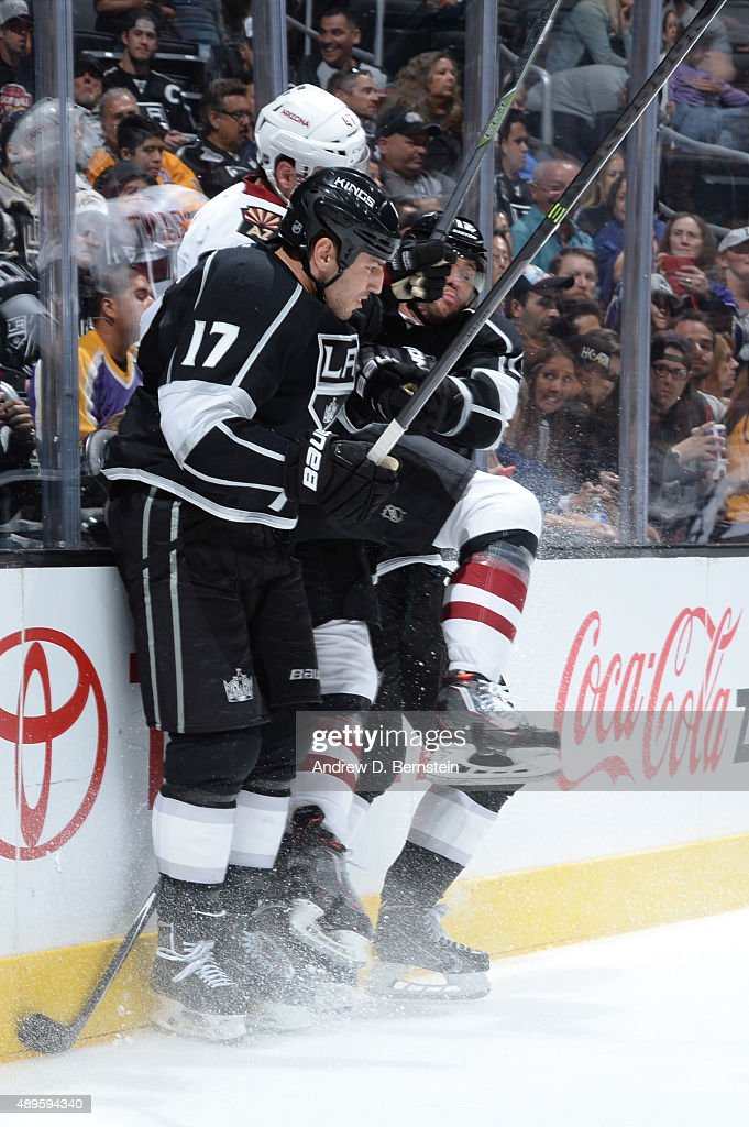 Milan Lucic #17 and Marian Gaborik #12 of the Los Angeles Kings check Zbynek Michalek #4 of the Arizona Coyotes into the board during a game at STAPLES Center on September 22, 2015 in Los Angeles, California.