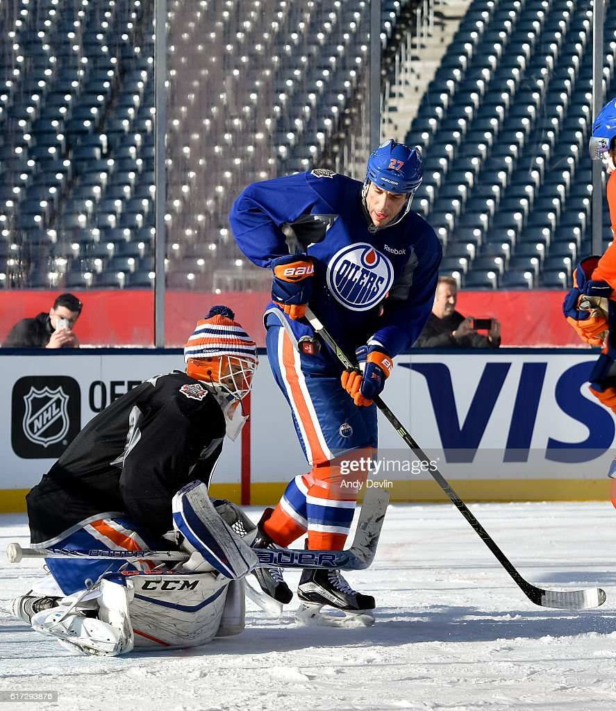 Milan Lucic #27 battles in front of Cam Talbot #33 of the Edmonton Oilers during practice in advance of the 2016 Tim Hortons NHL Heritage Classic game at Investors Group Field on October 22, 2016 in Winnipeg, Canada.