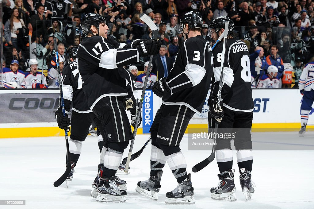 Milan Lucic #17, Brayden McNabb #3, and Drew Doughty #8 of the Los Angeles Kings celebrate during a game against the Edmonton Oilers at STAPLES Center on November 14, 2015 in Los Angeles, California.