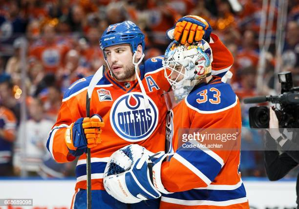 Milan Lucic congratulates goalie Cam Talbot of the Edmonton Oilers on his shutout victory against the San Jose Sharks in Game Two of the Western...