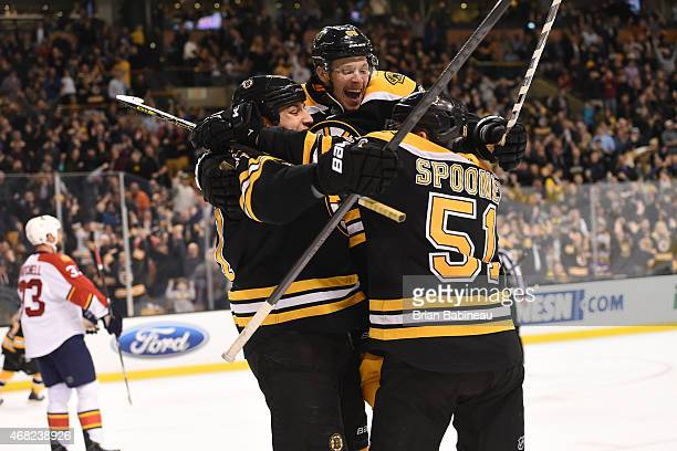 Milan Lucic David Pastrnak and Ryan Spooner of the Boston Bruins celebrate a goal against the Florida Panthers at the TD Garden on March 31 2015 in...