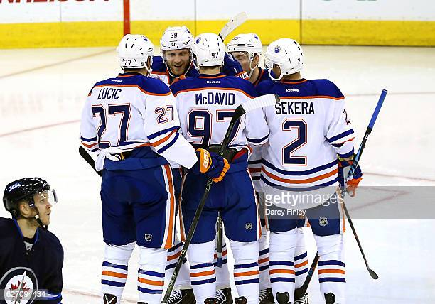 Milan Lucic Leon Draisaitl Connor McDavid Mark Letestu and Andrej Sekera of the Edmonton Oilers celebrate a second period goal against the Winnipeg...