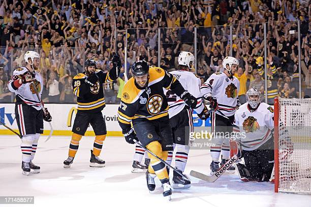 Milan Lucic of the Boston Bruins celebrates after scoing a goal in the third period against Tuukka Rask of the Boston Bruins in Game Six of the 2013...