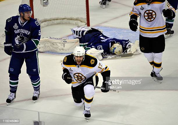 Milan Lucic of the Boston Bruins celebrates after scoring a goal against Roberto Luongo of the Vancouver Canucks in the second period during Game Two...