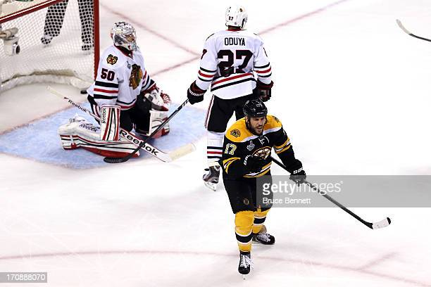Milan Lucic of the Boston Bruins celebrates after scoring a goal against Corey Crawford of the Chicago Blackhawks in the second period in Game Four...