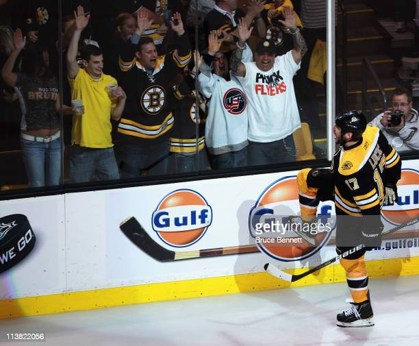 Milan Lucic of the Boston Bruins celebrates his goal at 1503 of the third period against the Philadelphia Flyers in Game Four of the Eastern...