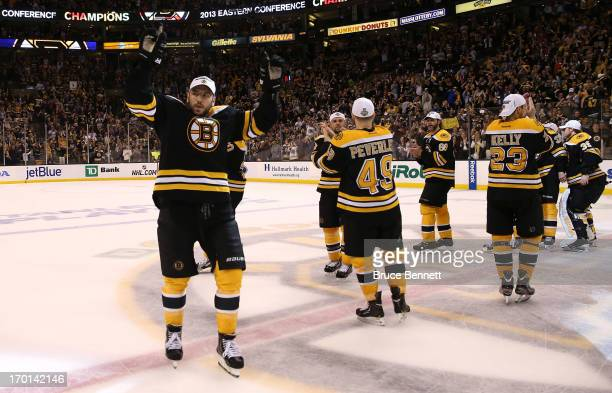 Milan Lucic of the Boston Bruins celebrates with teammates after defeating the Pittsburgh Penguins 1-0 in Game Four of the Eastern Conference Final...