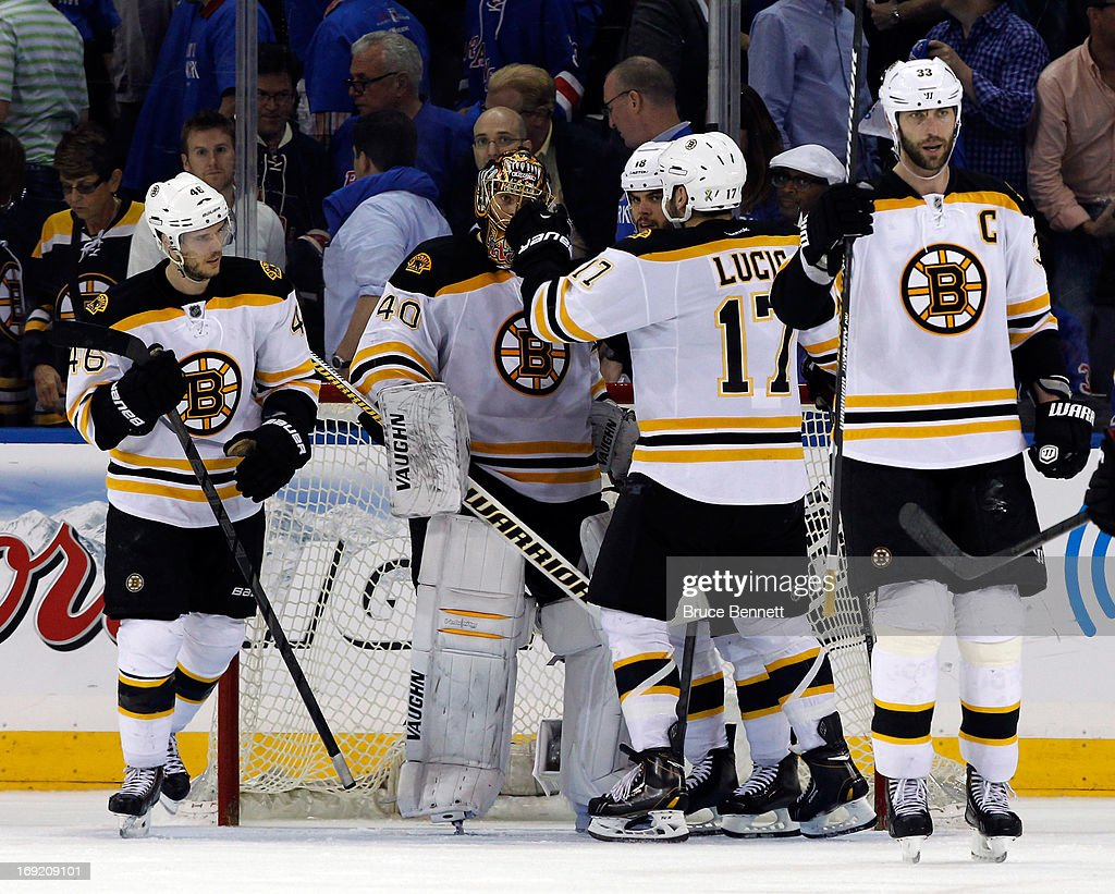 Milan Lucic #17 of the Boston Bruins celebrates with Tuukka Rask #40 after defeating the New York Rangers in Game Three of the Eastern Conference Semifinals during the 2013 NHL Stanley Cup Playoffs at Madison Square Garden on May 21, 2013 in New York City. The Boston Bruins defeated the New York Rangers 2-1.