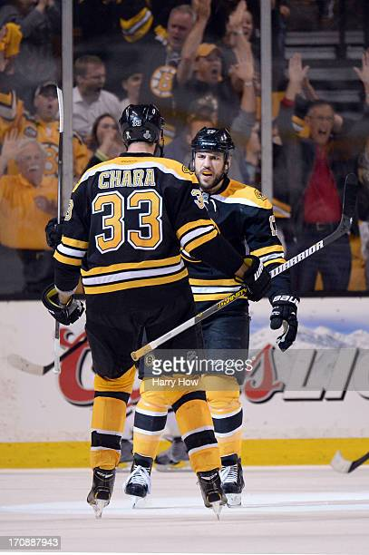 Milan Lucic of the Boston Bruins celebrates with Zdeno Chara after Lucic scores a goal in the second period against the Chicago Blackhawks in Game...