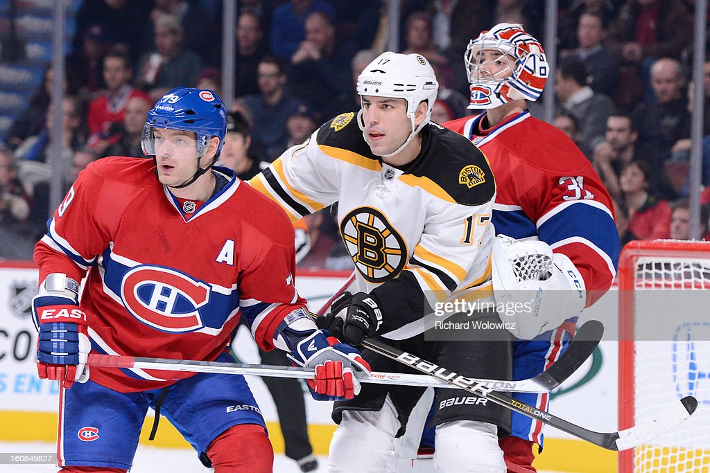 Milan Lucic #17 of the Boston Bruins clears Andrei Markov #79 from in front of \Carey Price #31 of the Montreal Canadiens during the NHL game at the Bell Centre on February 6, 2013 in Montreal, Quebec, Canada. The Bruins defeated the Canadiens 2-1.