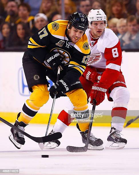 Milan Lucic of the Boston Bruins fights for the puck with Justin Abdelkader of the Detroit Red Wings in the first period in Game Five of the First...