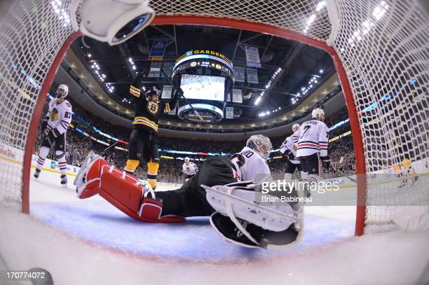Milan Lucic of the Boston Bruins scores a goal against Corey Crawford of the Chicago Blackhawks in Game Three of the Stanley Cup Final at TD Garden...